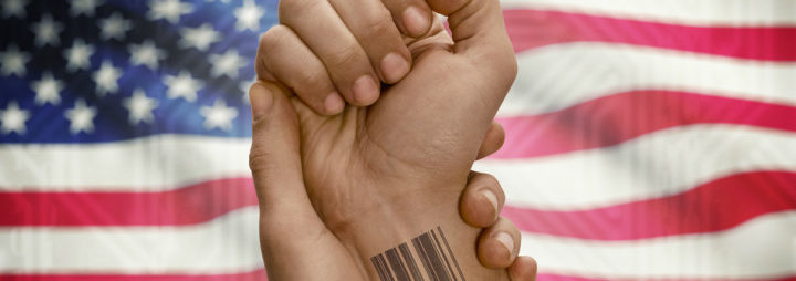 tatto tracking and your righs - hand showing barcode tattoo on wrist